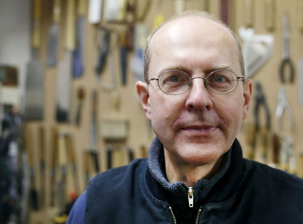 Canadian-born furniture-maker Michael Ibsen, a direct descendant of the eldest sister of medieval British King Richard III, poses in his furniture workshop in London. An archaeological thriller has ignited a passion for history in Britain, where ongoing D