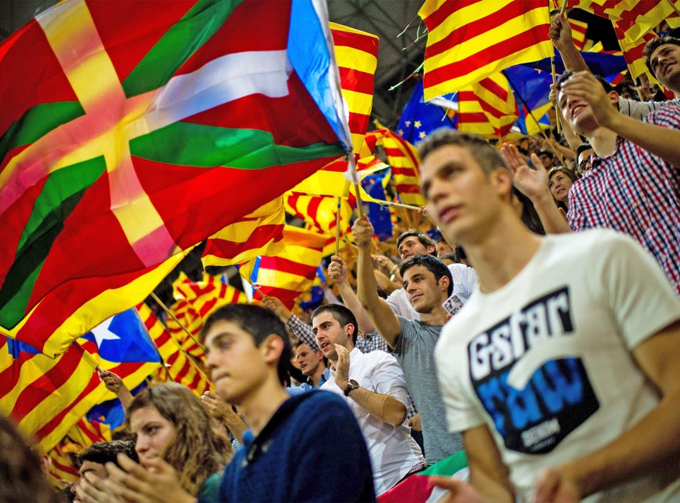 Supporters of the Pro-independence Catalan party Convergence and Union (CIU) fly a Basque Country flag