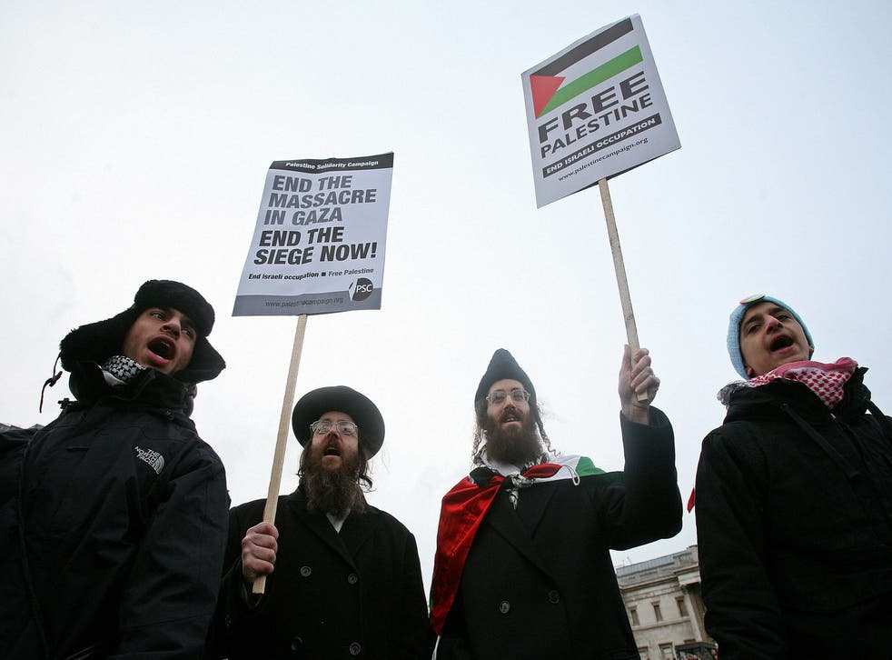 Orthodox Jews (C) protest at a demonstration in Trafalgar Square, London on January 17, 2009. Thousands of protesters calling for Israel to stop its offensive in the Gaza Strip rallied in European cities. In London, some 3,500 people filled Trafalgar Square, police said, for a protest billed as a 'demonstration against Israel's barbarity and war crimes'.