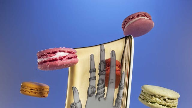 Hand tray by Fornasetti, £175, Liberty; macarons, from a selection, Laduree