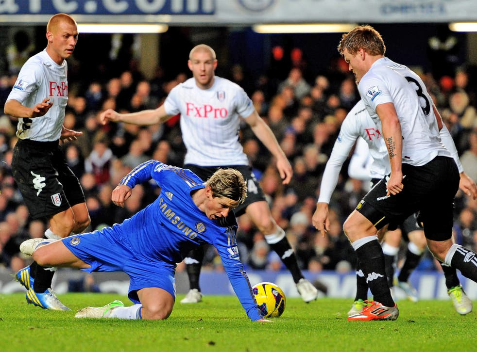 Chelsea's Fernando Torres fails to find a way through the Fulham defence last night