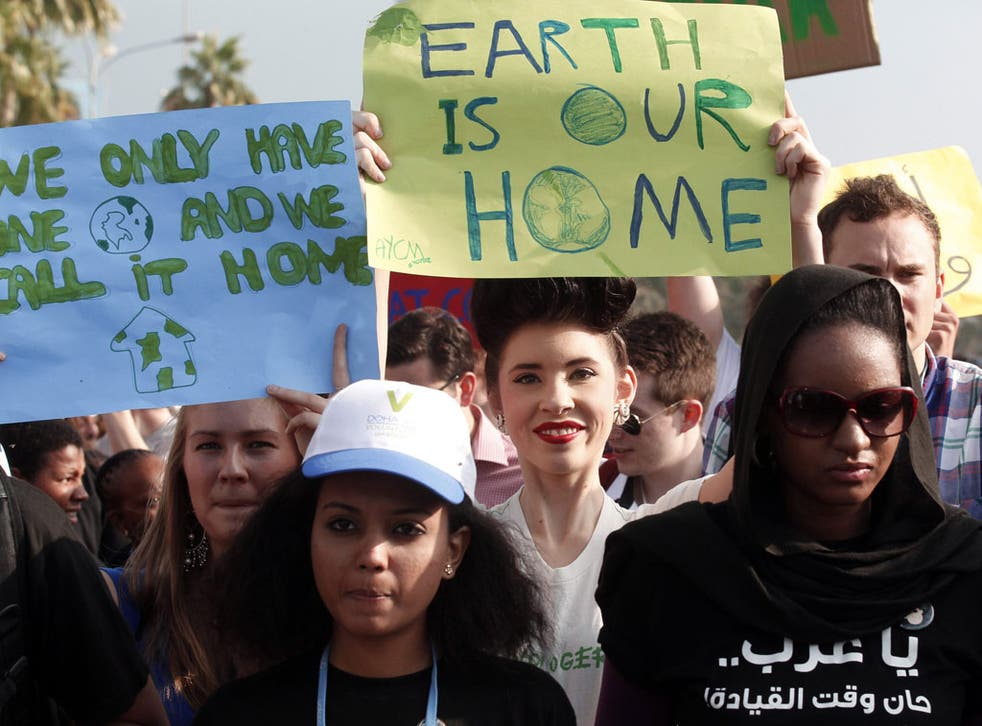 Protestors demand action to address climate change in Doha yesterday