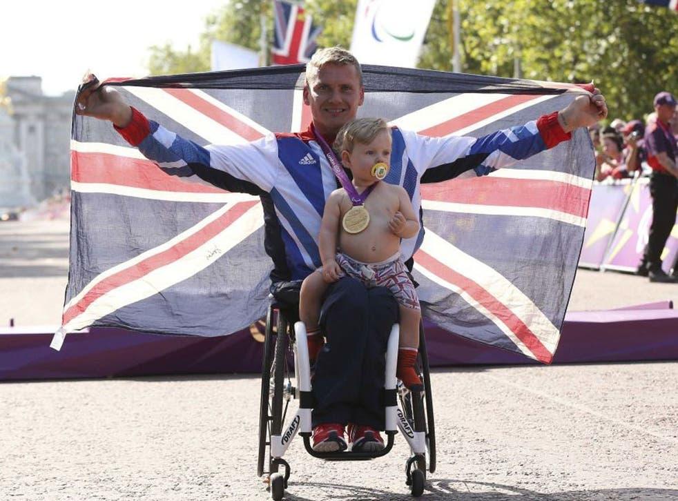 David Weir celebrates with his son Mason after winning the men's marathon T54 yesterday
