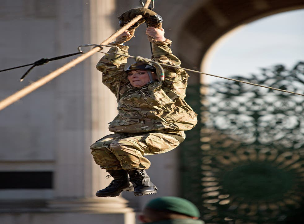 Presenter Lorraine Kelly descends the zip line toward the Royal Marine saftey crew from Wellington Arch in Central London, to launch the annual Christmas Box campaign for the Armed Forces, run by the charity uk4u Thanks!