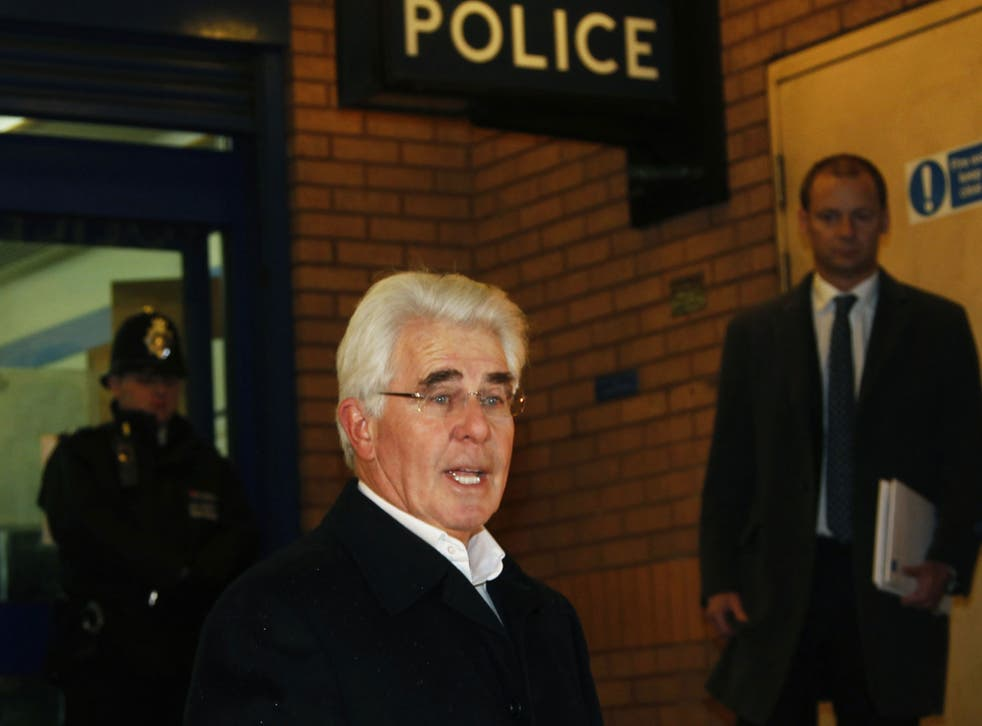 Max Clifford reads a statement after leaving Belgravia police station in London