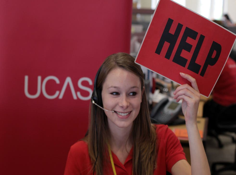 Sam Wathen, an employee in the UCAS clearing house call centre calls for assistance and advice from a supervisor August 18, 2010 in Cheltenham, England.