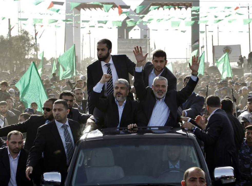 Hamas chief Khaled Meshaal, front left, alongside Hamas leader Ismail Haniyeh in Gaza yesterday