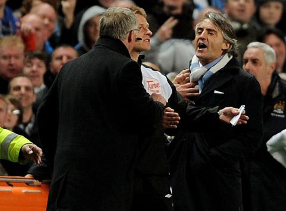 Roberto Mancini (right) and Alex Ferguson have a frank exchange of views at the Etihad in April