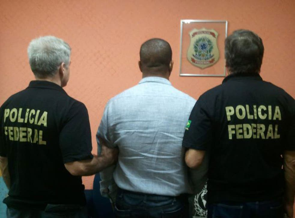 Michael Misick is led away by police in Rio de Janeiro