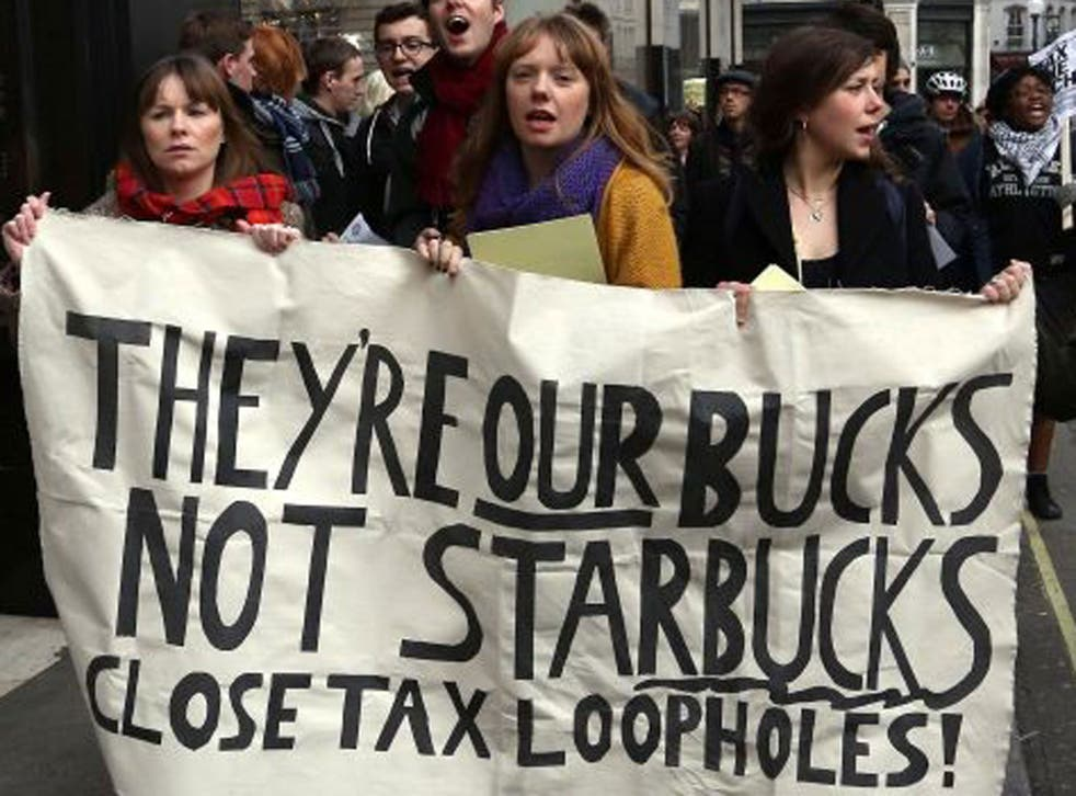 UK Uncut activists protesting against Starbucks's tax arrangements