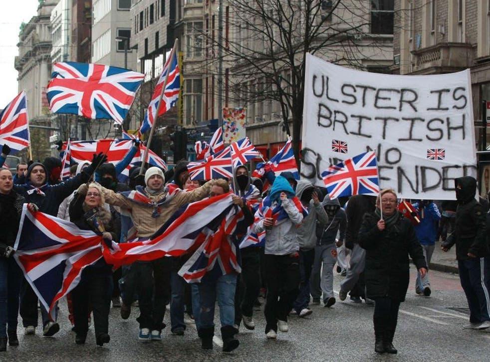 Loyalist march waving British Union Flags in Belfast