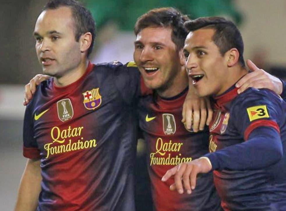 Lionel Messi (centre) celebrates breaking Gerd Müller's record