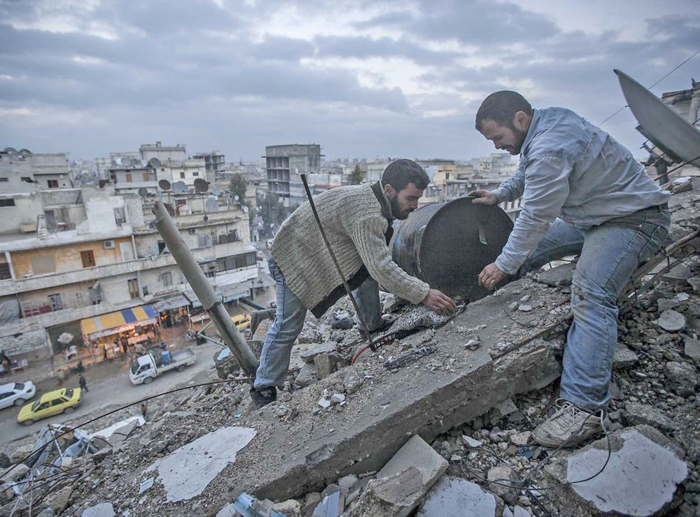 Residents pick through the rubble left after months of heavy fighting in Homs. While mostly calm, periodic explosions still rock the city