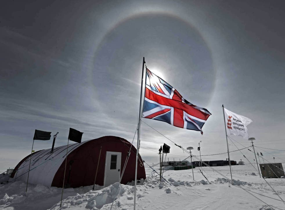 ANTARCTICA: The sun shines through a British flag over the field camp of the Lake Ellsworth drilling project in near the Ellsworth Mountains of Antarctica.