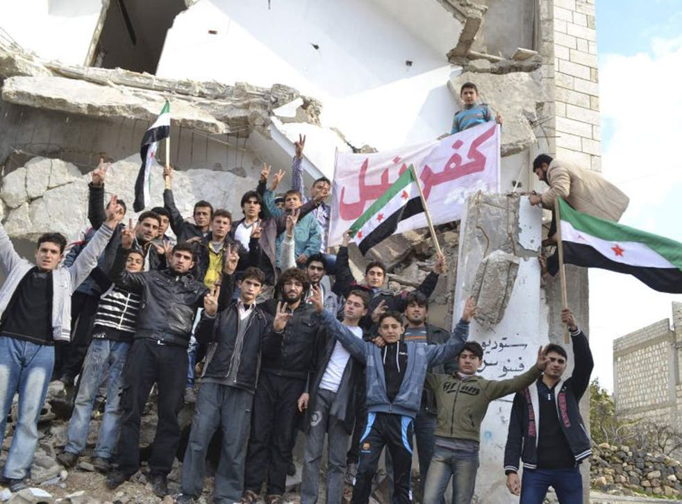 Anti-regime protesters in Idlib province. The rebels appear to be gaining more ground from President Assad's forces