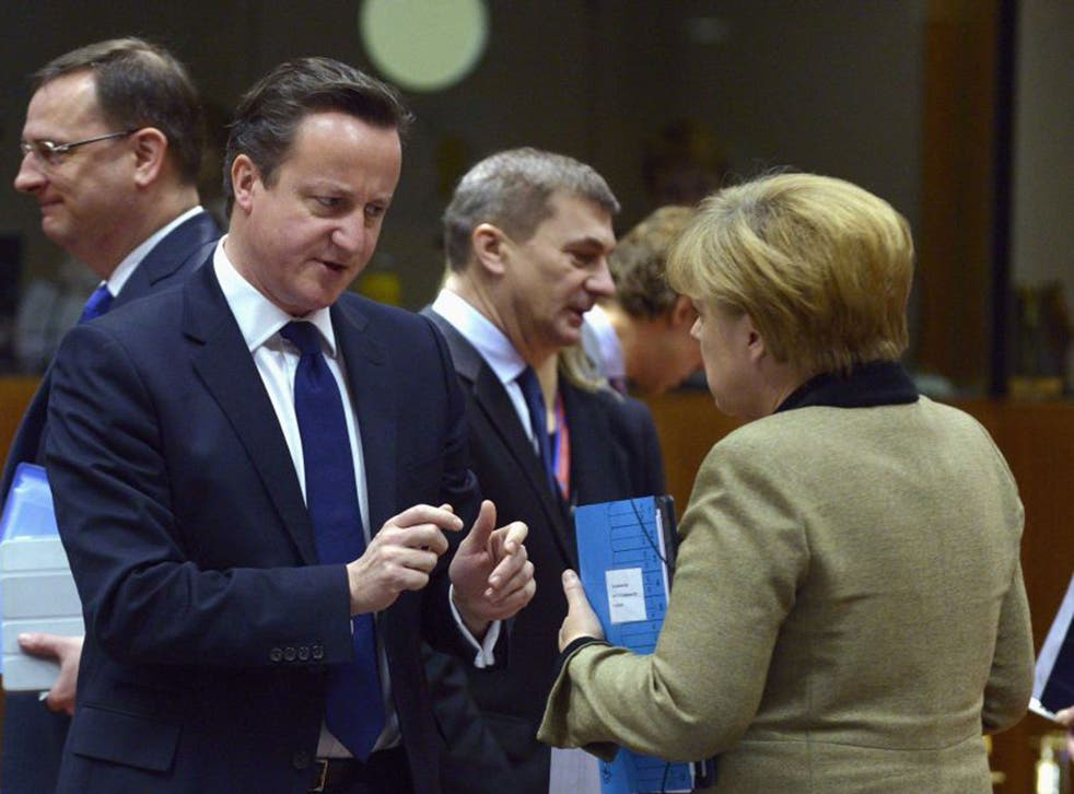 David Cameron puts his case to the German Chancellor, Angela Merkel, in Brussels yesterday