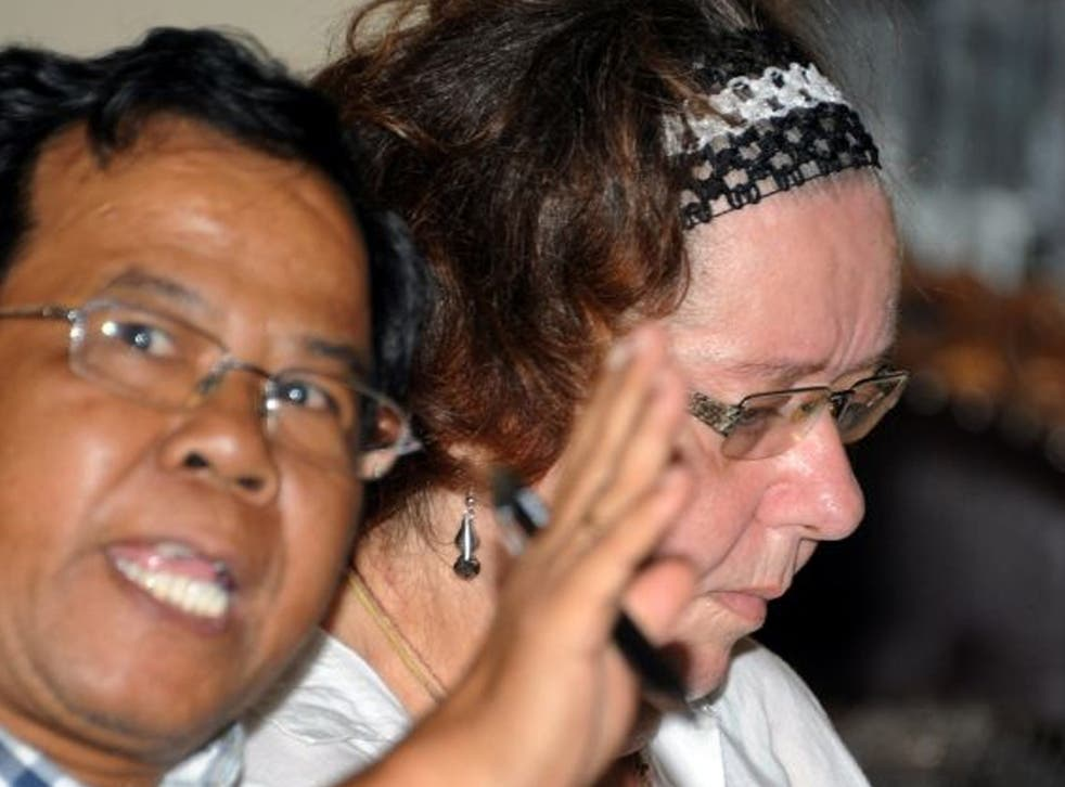 Sandiford (right) of Britain with her interpreter during the trial on the Indonesian resort island of Bali