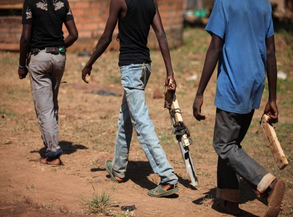 During the role-play, some of the children act out the part of the militiamen. They create imitation weapons out of pieces of wood and plastic.