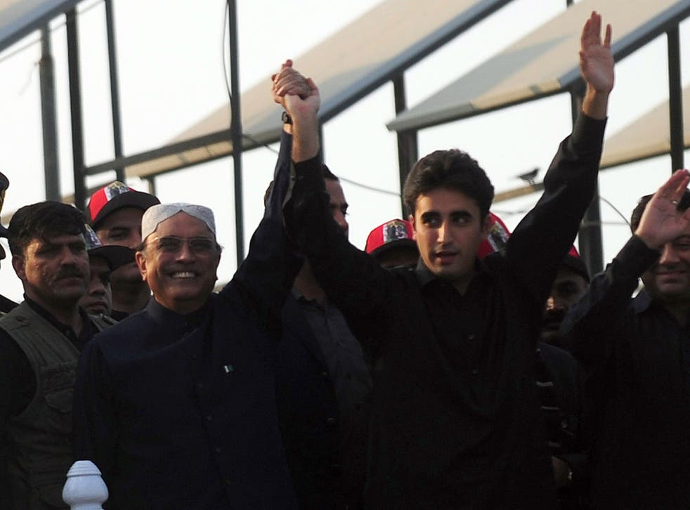 President Asif Ali Zardari, left, widower of Benazir Bhutto, with his son and chairman of the People's Party Bilawal