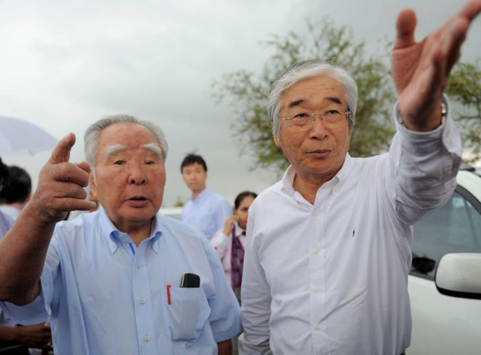 Osamu Suzuki, left, is the fourth adopted son to run the family company