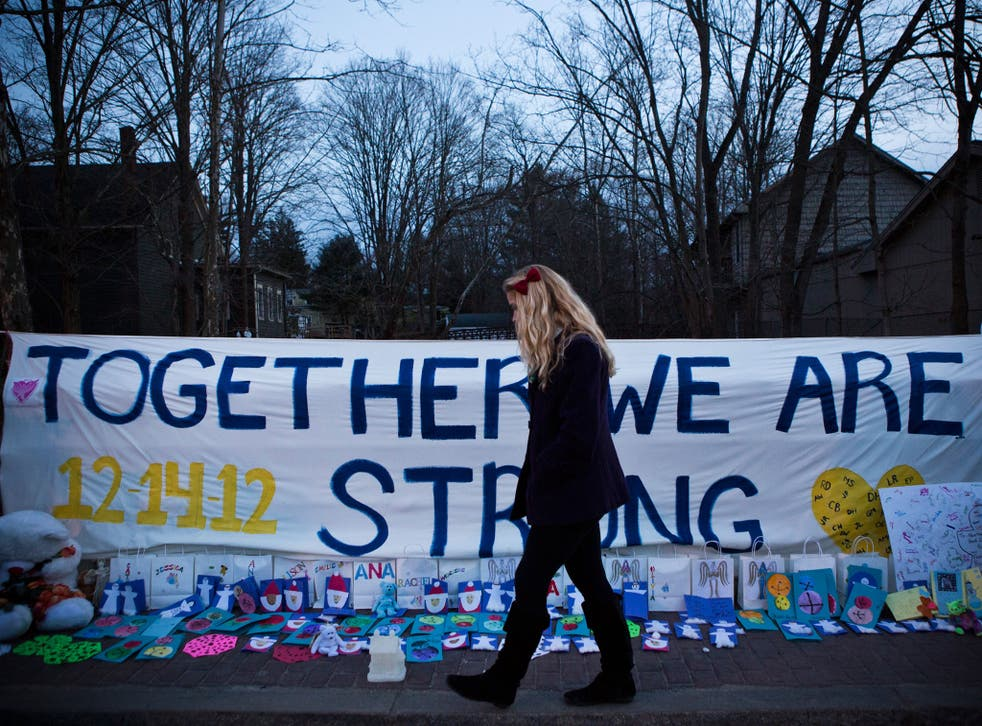 Newtown: Obama wants action with a year on guns
