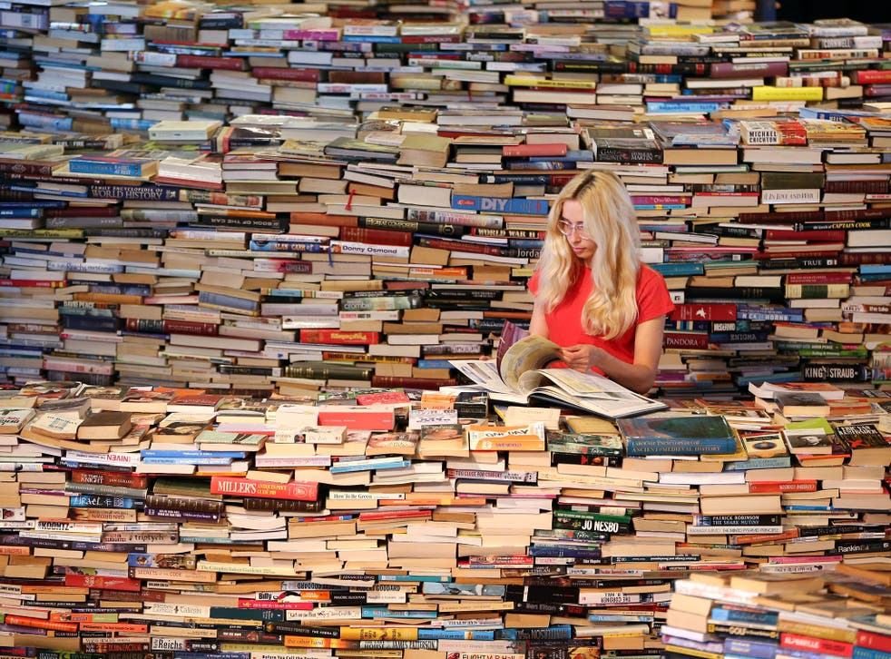 Employee Tilly Shiner looks at a book in the aMAZEme labyrinth at The Southbank Centre on July 31, 2012 in London, England.