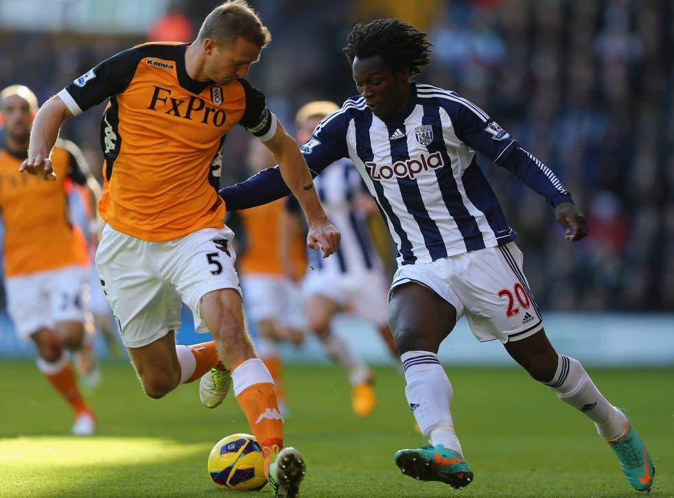 West Brom's goalscorer Romelu Lukaku takes on Fulham defender Brede Hangeland