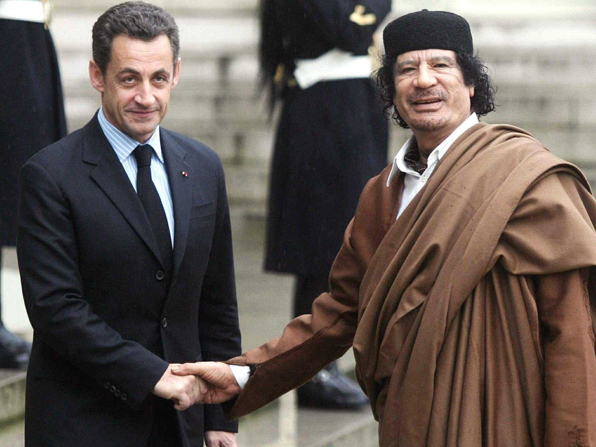 Image result for sarkozy gaddafi