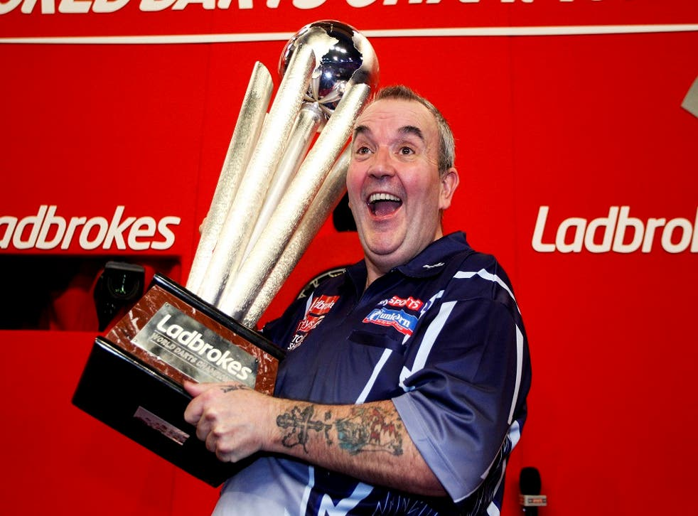 Phil Taylor celebrates winning the 2013 World Darts Championship