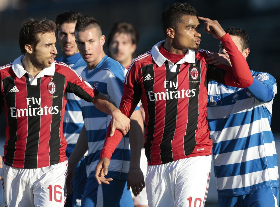 Milan's Kevin-Prince Boateng gestures towards his abusers