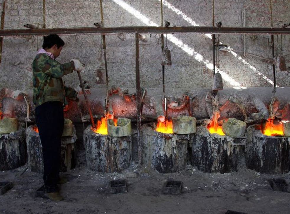 A Chinese worker smelts the rare earth metal Lanthanum