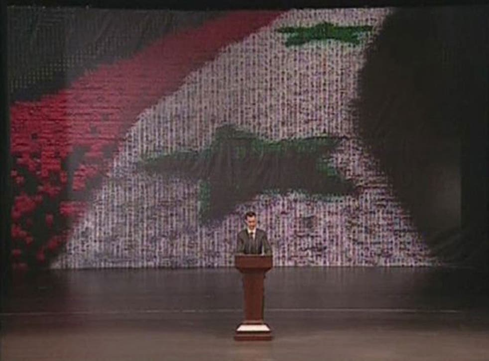 Syria's President Bashar al-Assad speaks at the Opera House in Damascus in this still image taken from video