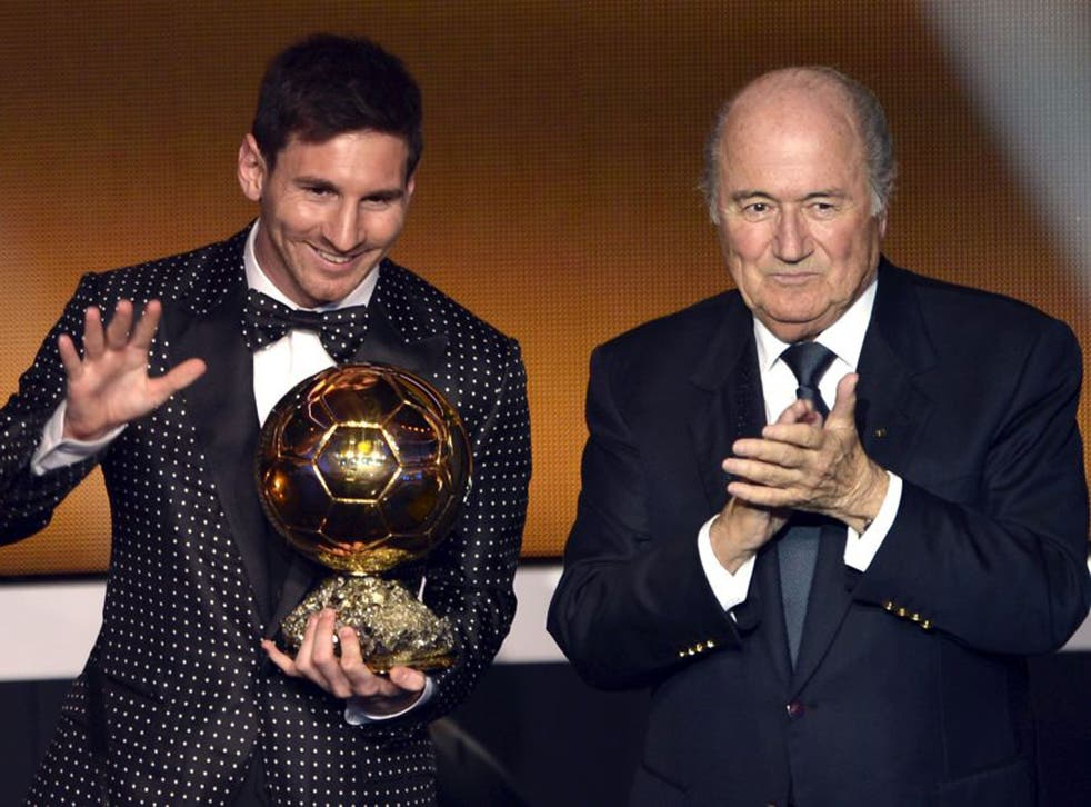 Lionel Messi receives the Ballon d'Or last night from Sepp Blatter in Zurich