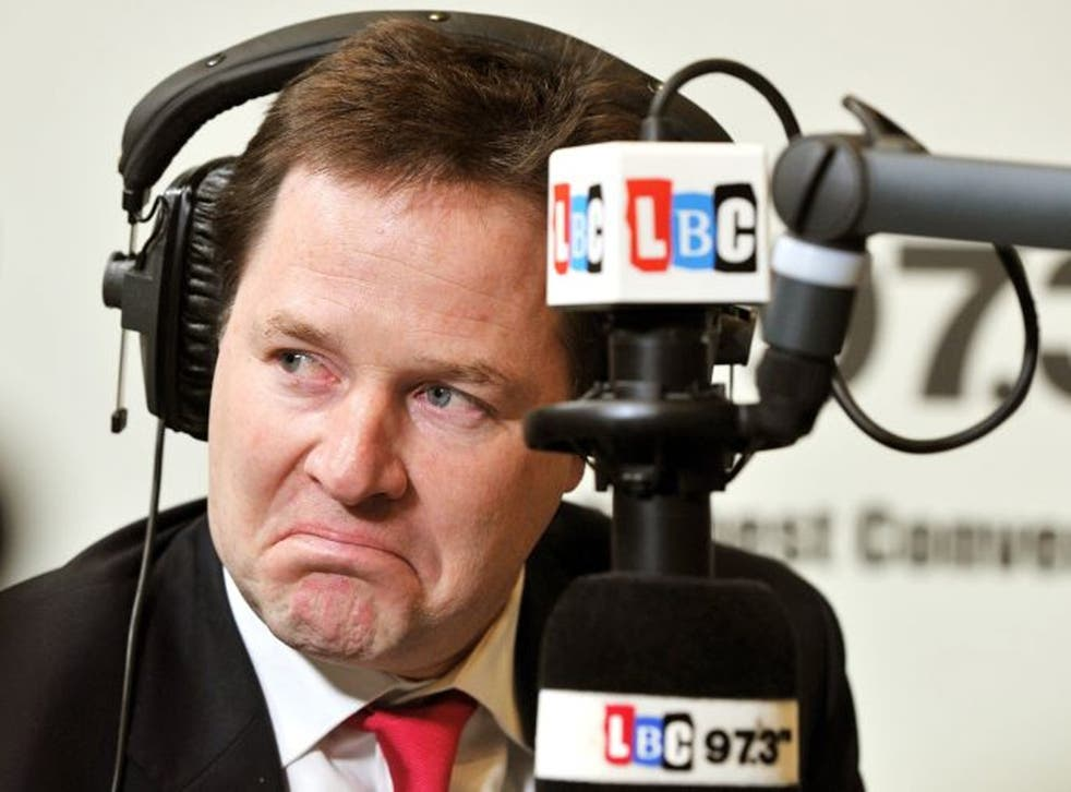 The Deputy Prime Minister Nick Clegg listens to a question from a listener during the LBC radio phone-in programme with host Nick Ferrari
