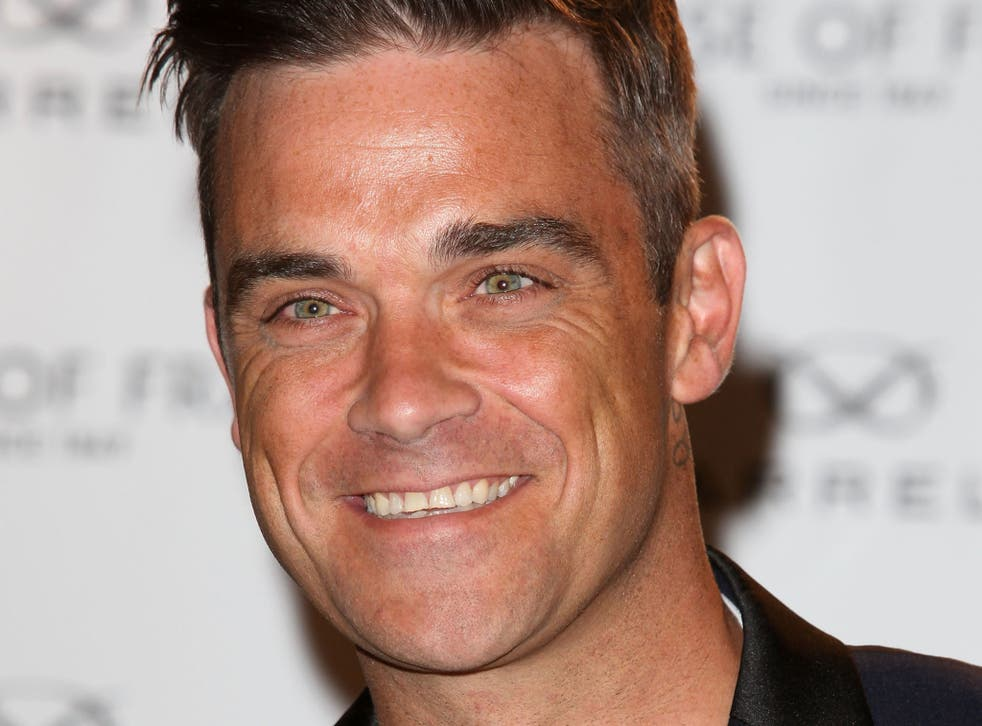Robbie Williams has said he's 'gutted' Radio 1 won't play his singles