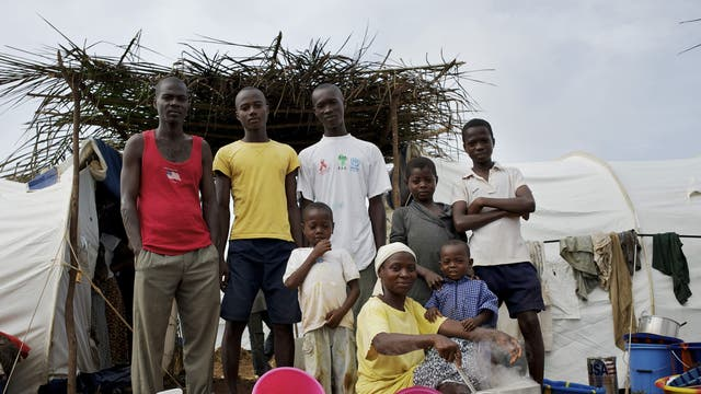Blagnon Gnepa family, Harper, Liberia <p>The Blagnon Gnepa family live in a temporary refugee camp for Ivorians fleeing the violence across the border, and are given essential rations such as oil and grains.</p>