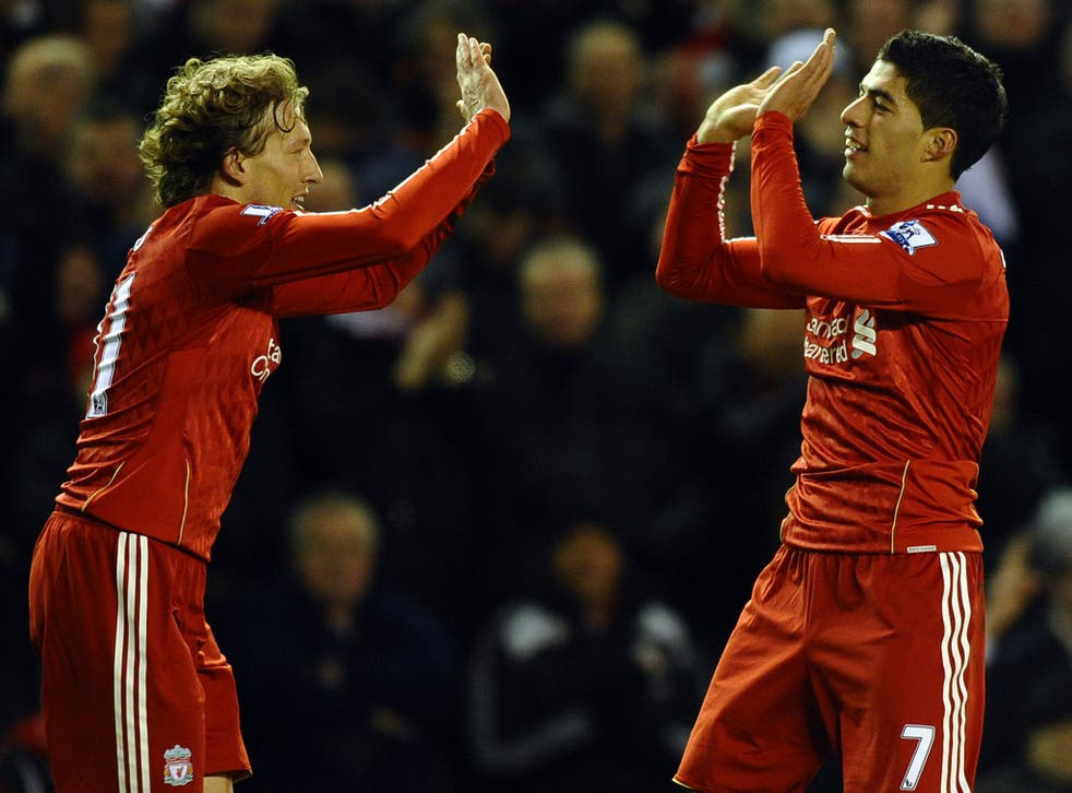 Put it there: Lucas Leiva (left) has established a close bond with Luis Suarez and his family