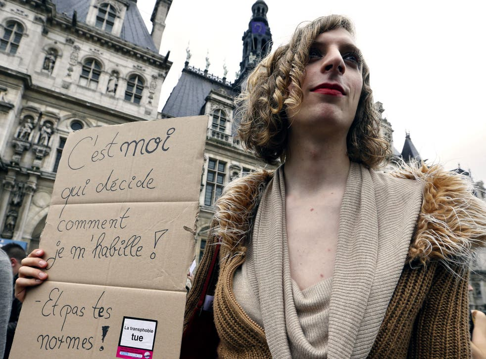 The placard reads 'I am the one who decide how I dress and not your standards'. Photo taken at the 16th Existrans, a parade to fight for the rights of transsexual and transgender people on October 20, 2012 in Paris.
