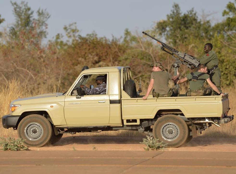 French soldiers aboard a Malian military car at a military airbase near Bamako