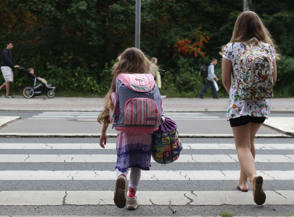 Children walk down the way on the first school day on August 23, 2010 in Berlin, Germany.