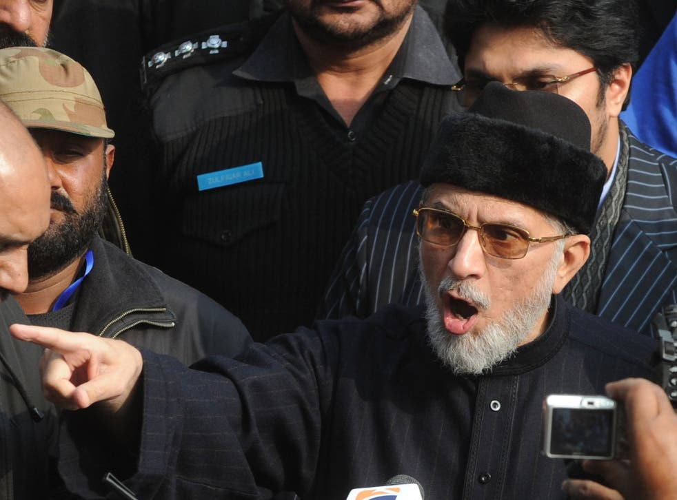 Pakistani religious leader Tahir-ul Qadri talks with media representatives before the start of protest march in Lahore on January 13, 2013.