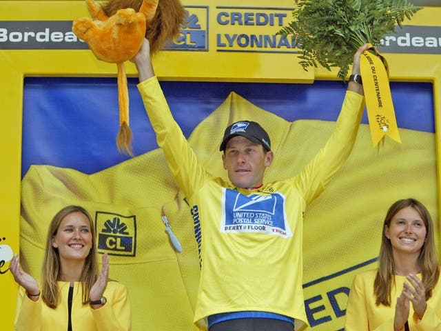Lance Armstrong wears the yellow jersey of the Tour de France leader as he claims his fifth title. He was later stripped of all seven
