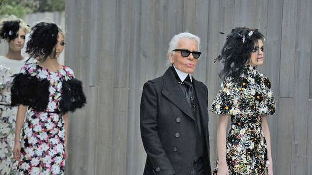 Designer Karl Lagerfeld walks the runway with models during the Chanel Spring/Summer 2013 Haute-Couture show as part of Paris Fashion Week at Grand Palais