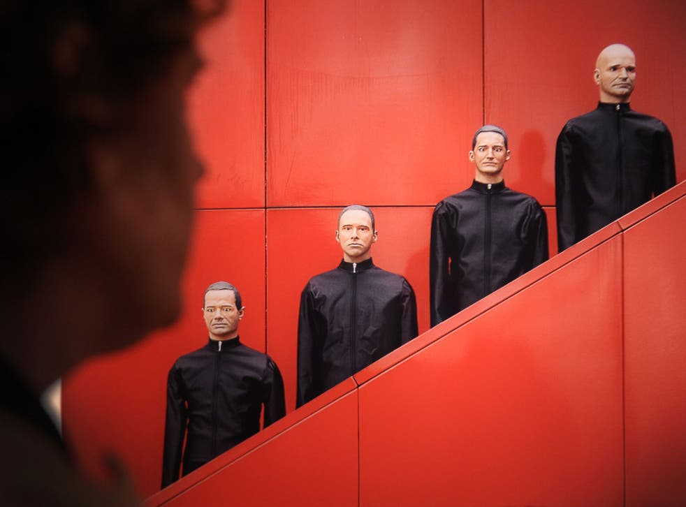 Gang of four: Kraftwerk are as likely to field robots as appear in person