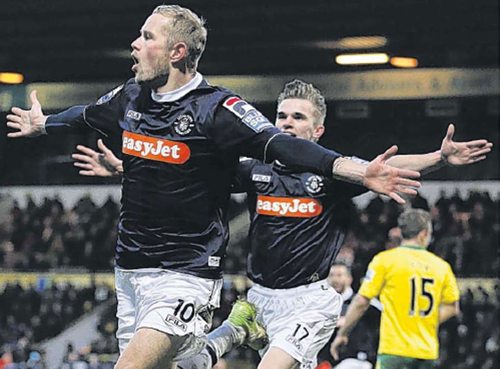 Scott Rendell celebrates his goal at Norwich that gave Luton a historic win