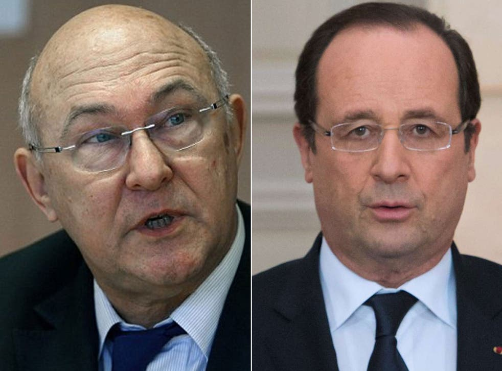Michel Sapin and Francois Hollande