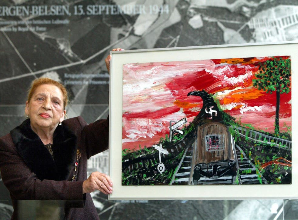Stojka in 2003 with one of her paintings, 'Vienna-Auschwitz'