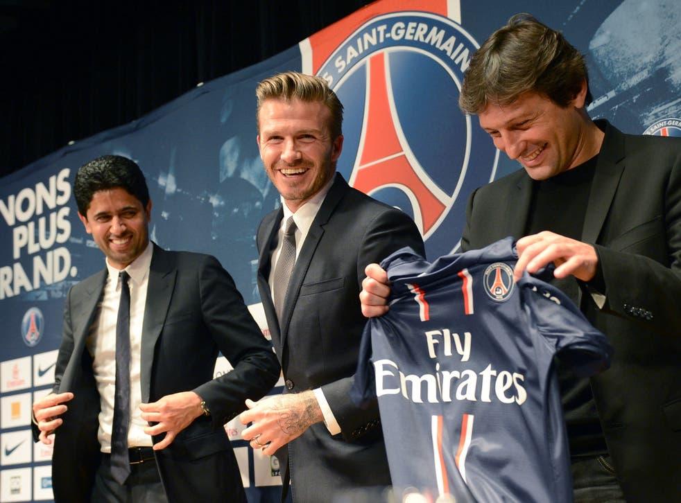 David Beckham is unveiled as a Paris Saint-Germain player by the club president, Nasser al-Khelaifi, and director of football, Leonardo