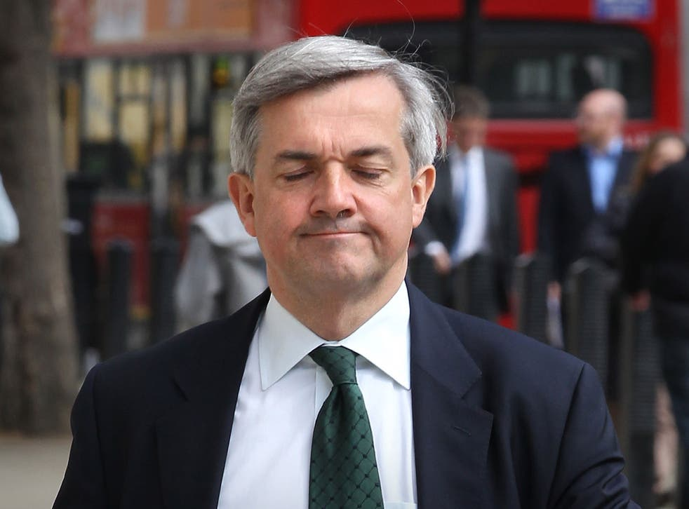 Energy Secretary Chris Huhne arrives at The Cabinet Office entrance for a Cabinet meeting on May 17, 2011 in London, England.