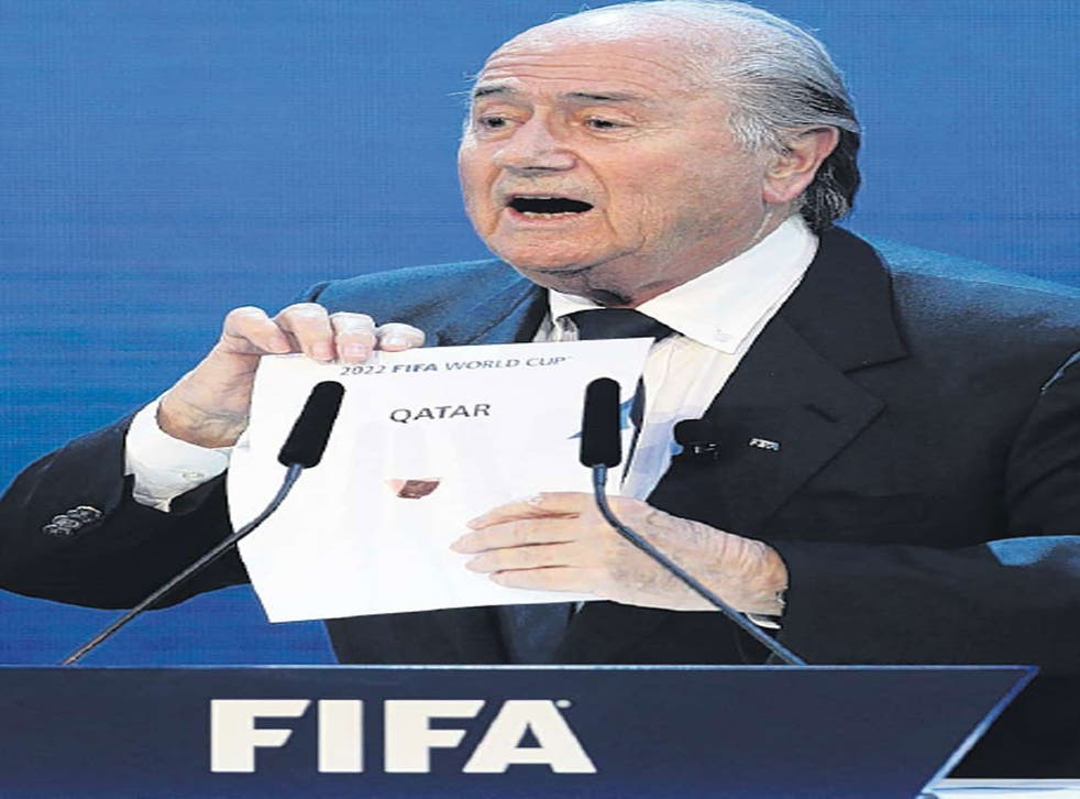 Fifa's Sepp Blatter reveals Qatar as the hosts of the 2022 World Cup